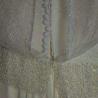 Lila robe de mariée d'occasion détail du dos